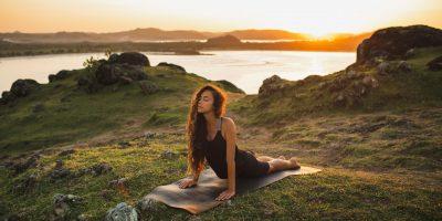 woman-training-outdoors-on-yoga-mat-at-sunrise